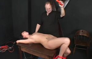 Dark?haired whore, trussed & waxed by..