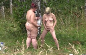 bare gals in the forest. peeping,..