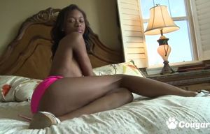 Becky cohen plays with her thin ebony..